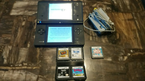 Nintendo DSi with games and charger