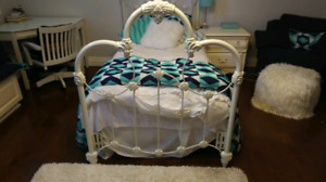 Single Bed Frame with mattress and bed side table.