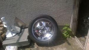 "PRICE REDUCED.....Toyo tires and 22"" rims $800.00"