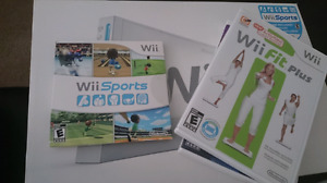 Wii console with 3 games and balance board in box.