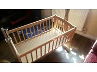 Wooden rocking crib cot