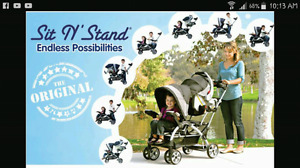 Sit and stand stroller in red and black