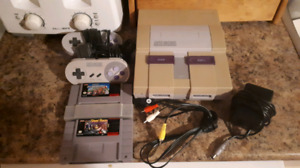 Super Nintendo System With 2 Controllers And 2 Games!