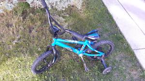 "14"" blue Norco bike"