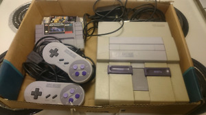 Super Nintendo system w/ 2 controllers and hook ups and 2 games