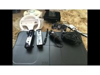 Black Wii & Fit Plus Board, Rechargeable Controllers, Wheels, Nunchucks, Loads of Games