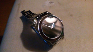 Movado Swiss made modern men's watch Authentic and working. 200