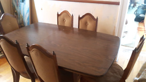 Antique table with 6 chairs plus leaf