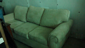 White suede couch and chair