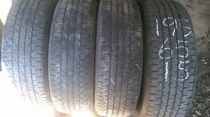 Four Firestone 195 65 15 all season tires.