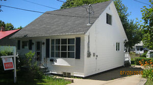 REDUCED ! 4 BR. IN THE HEART OF TOWN. TONS OF UP GRADES