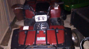 Two atvs for trade for small tractor