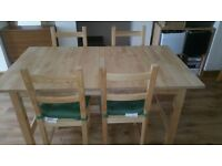 Ikea Dining Table with 4 chairs. Including cushions