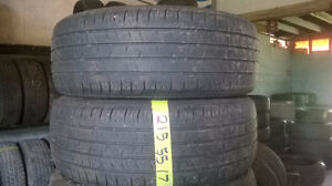 Two 215 55 17 all season tires.