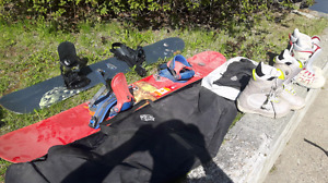 Two snowboards, 2 pairs boots and bag.