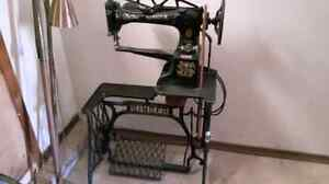 antique singer sewing machine $250. o.b.o.