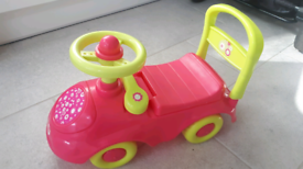 Pink and lime green ride on toy