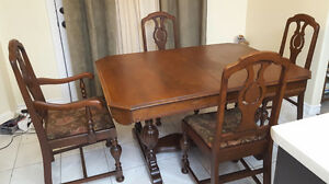 Krug Antique dining table with 6 chairs