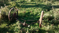 various steel wheels and old farm machinery.
