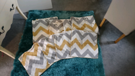 Two sets of curtains and four matching cushion covers