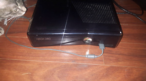 Xbox system 360 slim with tons of games..a few on system. 2 cont