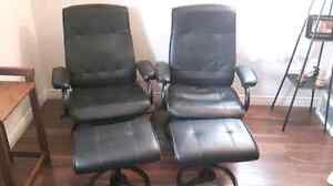 2 black leatherette reclining chairs and footstool