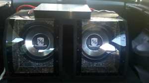 2 12 inch subs , amp, wires.  Glass front box.
