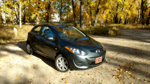 2011 Mazda2     LOW KM!!  Comes with winter tires on rims!