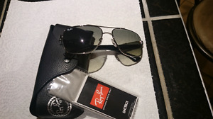 Two Authentic brand new sunglasses