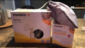 Medela Swing breast pump.  BRAND NEW in box Never used.