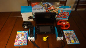 Wii U console with charging station + lots of games