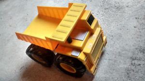 Various toy cars and trucks for sale