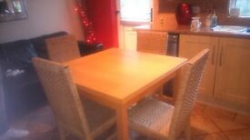 Extending dining table with 4 chairs in great condition