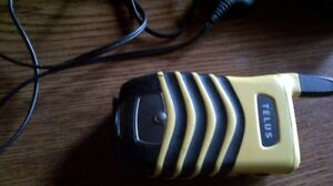 Motorola i560 with charger on with Tellus $45