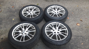 18 Inch OEM Infiniti Rims with tires. The bolt pattern 5x114.3