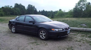 Black 4 Door Pontiac GrandPrix GT with SuperCharger