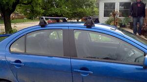 Yakima universal roof rack with 2 sets Mako kayak saddles