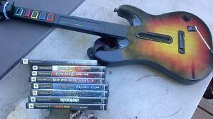 PS2 - Rockband / Guitar Hero with Guitar & Dongle London Ontario image 1
