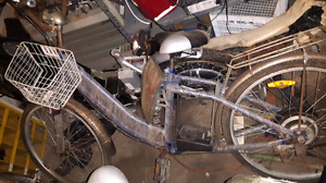 Assorted antique electric bikes
