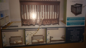Brand new 4 in 1 crib with new bamboo bed