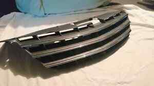 Front grill to a 2008 Dodge Avenger