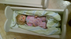 Wood cradle with baby