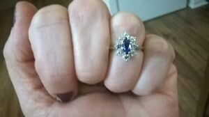 Marquis shaped simulated sapphire with 8 CZ stones surrounding