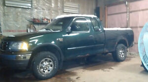 2000 Ford F-150 7700 Pickup Truck and 2003 parts truck