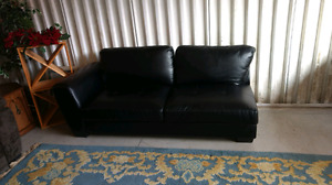 Black leather Sofa Sectional piece.