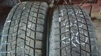 Two Bridgestone Blizzack P275 60 20 winter tires