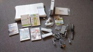 Console Wii avec deux manettes, 2 couvre-manettes et deux nunchu