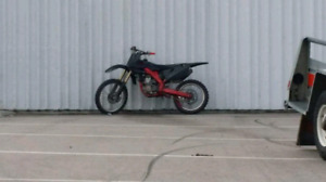 07 crf250r dual exhaust... Trade for 2 stroke or $3100