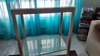quare display table with 2 glass shelves.has 4 wheels/casters fo