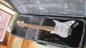 ELECTRIC GUITAR AND HARDSHELL CASE